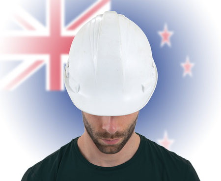 coal mine: Isolated engineer with flag on background - New Zealand Stock Photo
