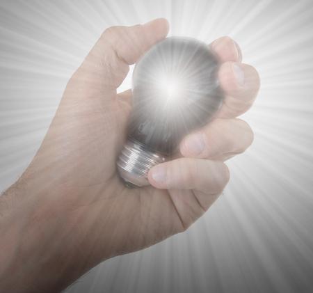 idea bulb: Hand holding an light bulb isolated on white background