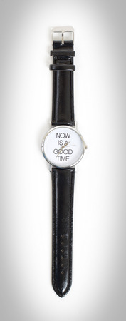 good time: Wrist watch with leather wristlet isolated, now is a good time