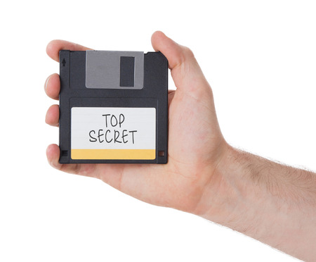 top secret: Floppy disk, data storage support, isolated on white - Top secret
