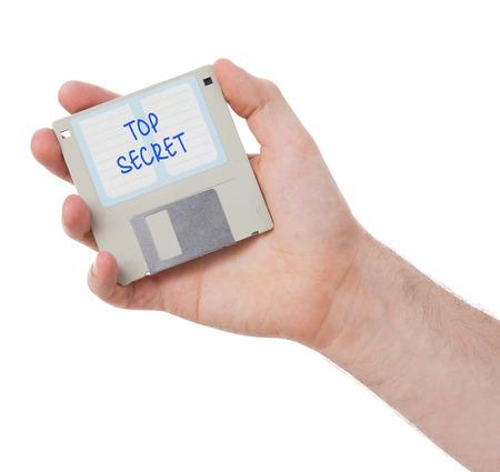 top secret: Floppy disk, data storage support, isolated on white - Top secret