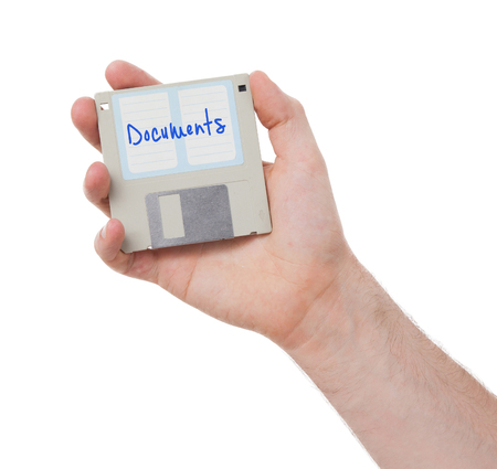 documenting: Floppy disk, data storage support, isolated on white - Documents Stock Photo