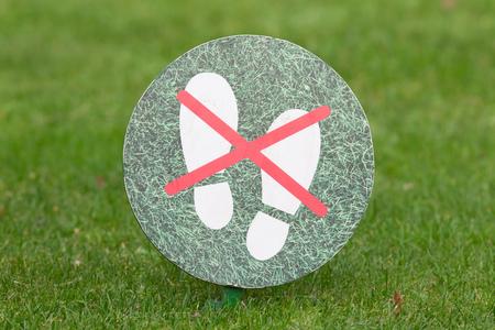 grass plot: Green do not step on grass sign