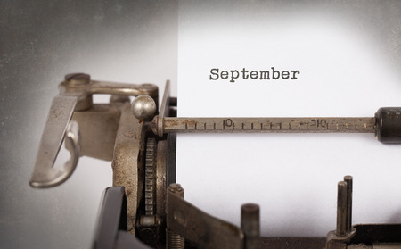 in september: Vintage inscription made by old typewriter - September