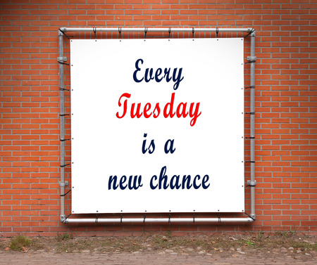 tuesday: Large banner with inspirational quote on a brick wall - Every tuesday is a new chance Stock Photo