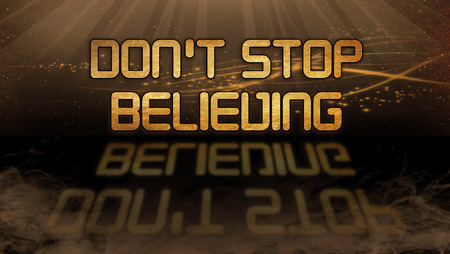 believing: Gold quote with mystic background - Dont stop believing Stock Photo
