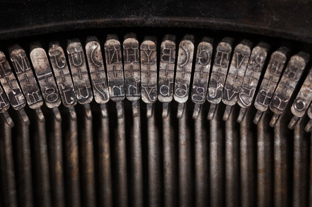 out dated: Types of vintage typewriter close-up, warm filter