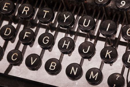 grope: Old typewriter keyboard - Vintage image, noise and scratches Stock Photo