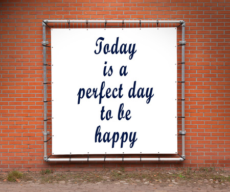 happynes: Large banner with inspirational quote on a brick wall - Today is a perfect day to be happy