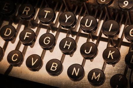 illiteracy: Old typewriter keyboard - Vintage image, noise and scratches Stock Photo
