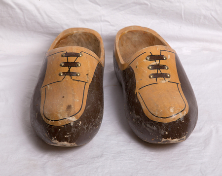 klompen: Pair of traditional Dutch wooden shoes on a white sheet