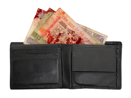 maffia: Gambian dalasi bank notes in a leather wallet, selective focus, blood