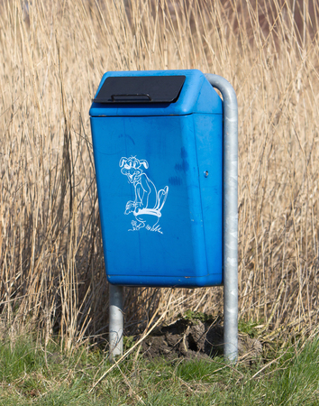 blue bin: Close up of bright blue dog mess poop bin with Label Stock Photo