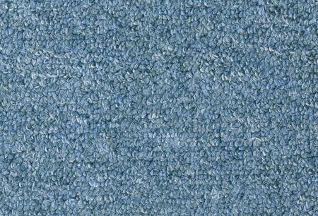 カーペットの質感クローズ アップ、青い毛皮で覆われたカーペットのテクスチャ背景
