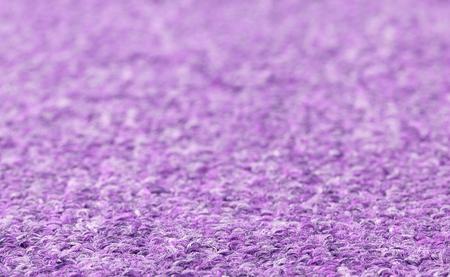 purple carpet texture. carpet texture close-up, purple furry background, selective focus photo