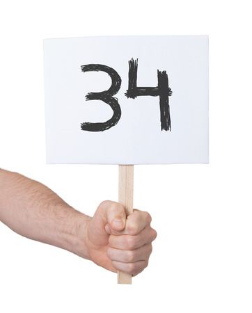 34: Sign with a number, isolated on white - 34