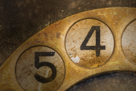 dialplate: Close up of Vintage phone dial, dirty and scratched - 4 Stock Photo