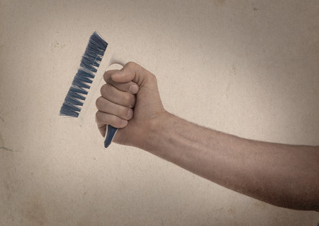sanitizing: Cleaning brush in hand isolated on white - Vintage Stock Photo