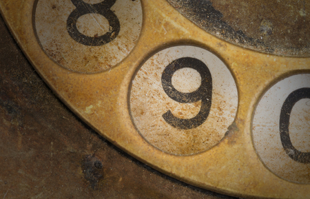 dial plate: Close up of Vintage phone dial, dirty and scratched - 9 Stock Photo