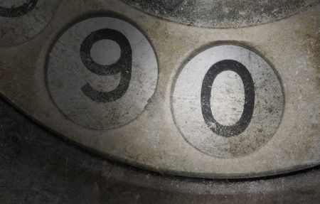 dialplate: Close up of Vintage phone dial, dirty and scratched - 0