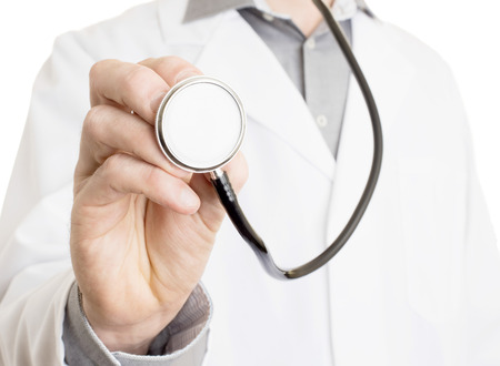 general practice: Close up of a Doctors hand, holding a stethoscope outstretched towards the viewer Stock Photo
