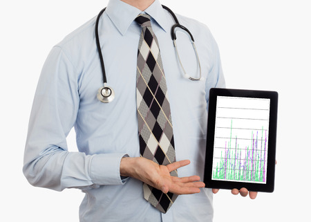 parameter: Doctor, isolated on white backgroun,  holding digital tablet - Graph Stock Photo