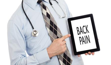 hidden danger: Doctor, isolated on white backgroun,  holding digital tablet - Back pain Stock Photo