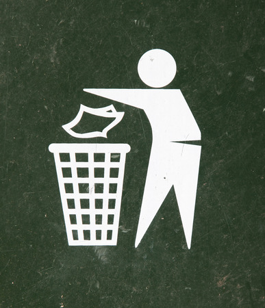reprocess: Close-up of a green bin, icon of man trowing something in bin