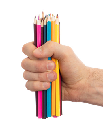 Used pencils in hand isolated on white background Archivio Fotografico