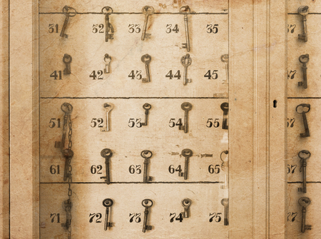 key cabinet: Vintage keys with numbers hanging in an old closet