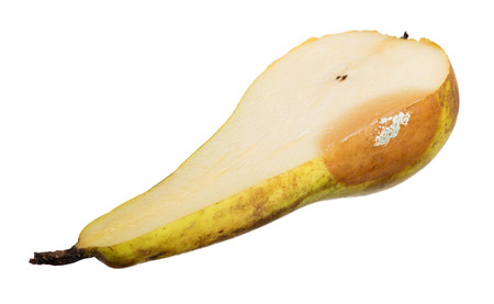 putrid: Close up of a pear with white area of fungus growing on it, isolated on white, selective focus Stock Photo