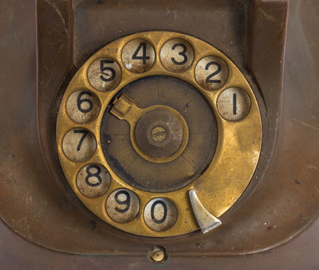 bakelite: Closeup of vintage telephone dial, scratched and filthy