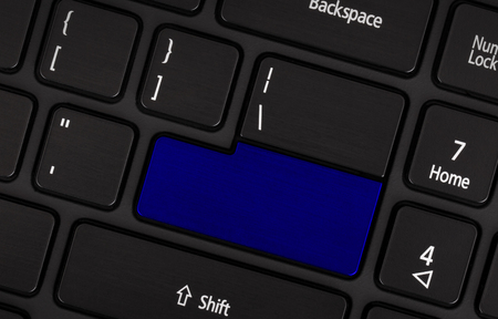 numpad: Laptop computer keyboard with blank blue button for text