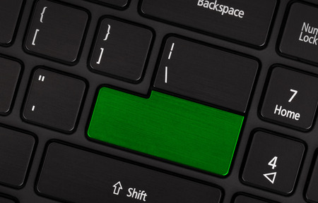numpad: Laptop computer keyboard with blank green button for text