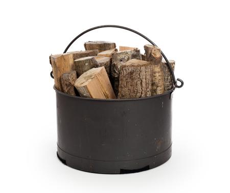 log basket: Metal basket of firewood, isolated on white