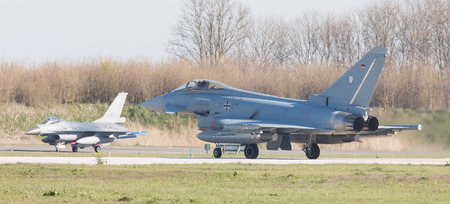 nato: LEEUWARDEN, NETHERLANDS - APRIL 11, 2016: German Air Force Eurofighter landing during the exercise Frisian Flag. The exercise is considered one of the most important NATO training events this year.
