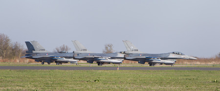 leeuwarden: LEEUWARDEN, NETHERLANDS - APRIL 11, 2016: A dutch F-16 on the ground during the exercise Frisian Flag. The exercise is considered one of the most important NATO training events this year.