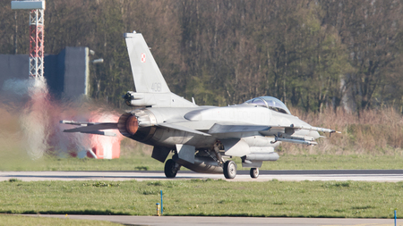 supersonic transport: LEEUWARDEN, THE NETHERLANDS - APRIL 11, 2016: Polish Air Force Lockheed F-16C Viper landing during the exercise Frisian Flag 2016. Leeuwarden Airbase april 11, 2016 in Leeuwarden, The Netherlands Editorial