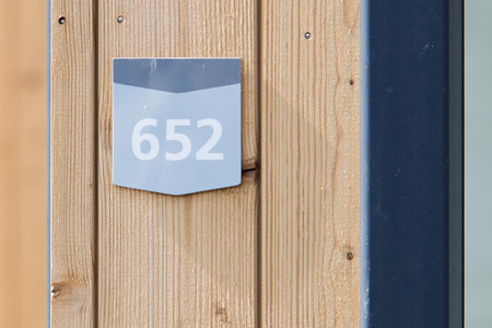 bungalow: 652 street number on a wooden bungalow Stock Photo