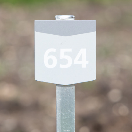 bungalow: 654 street number on a wooden bungalow Stock Photo