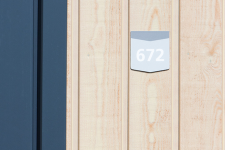 architecture bungalow: 672 street number on a wooden bungalow