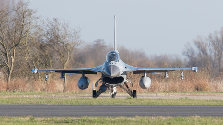 nato: LEEUWARDEN, NETHERLANDS - APRIL 11, 2016: A dutch F-16 on the ground during the exercise Frisian Flag. The exercise is considered one of the most important NATO training events this year.