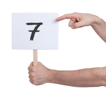 numeracy: Sign with a number, isolated on white - 7