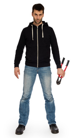 criminal activity: Robber with red bolt cutters, isolated on white Stock Photo