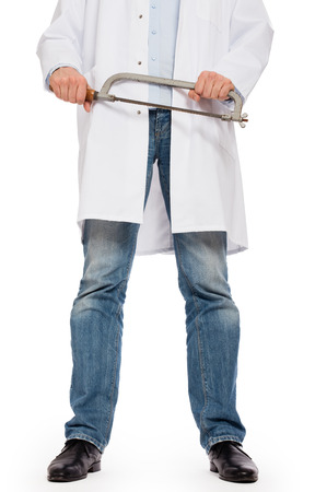 wacky: Crazy doctor is holding a big saw in his hands, isolated on white Stock Photo