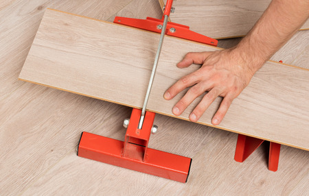Red Tool For Cutting Laminate On A Laminate Floor Stock Photo