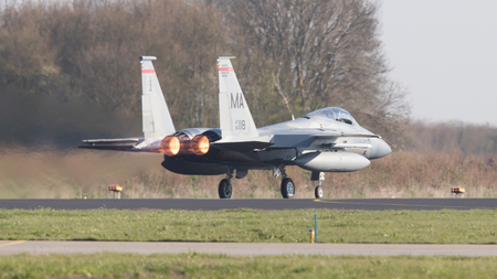 nato: LEEUWARDEN, NETHERLANDS - APRIL 11, 2016: US Air Force F-15 Eagle takking off during the exercise Frisian Flag. The exercise is considered one of the most important NATO training events this year. Editorial