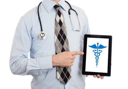 caduceus symbol: Doctor holding tablet, isolated on white - Caduceus symbol Stock Photo