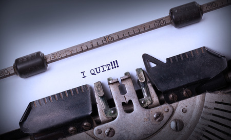 Vintage typewriter close-up - I Quit, concept of quitting Imagens