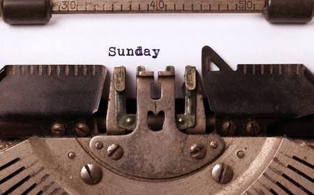 sunday: Sunday typography on a vintage typewriter, close-up Stock Photo